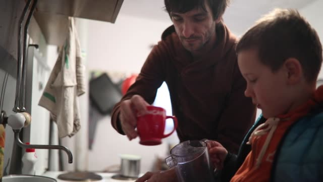 father and son washing dishes on countryside - washing up stock videos and b-roll footage
