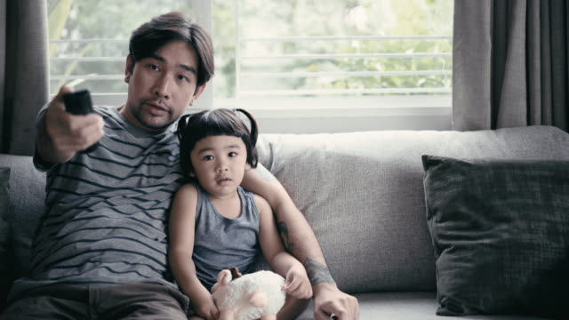 father and son watching tv - watching tv stock videos & royalty-free footage