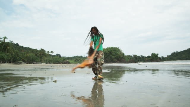 father and son with dreadlocks playing on the beach - dreadlocks stock videos & royalty-free footage