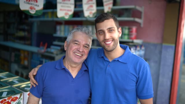 father and son working together in a paint store - spanish and portuguese ethnicity stock videos & royalty-free footage