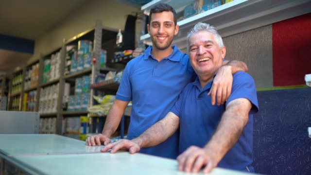 father and son working together in a paint store - salesman stock videos & royalty-free footage