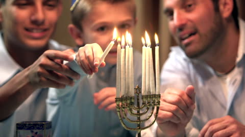 father and sons lighting menorah - judaism stock videos & royalty-free footage