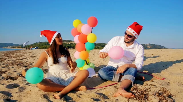 Father and teenage daughter celebrating Christmas holiday on the beach