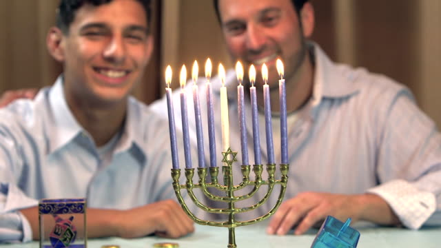 father and teenage son with menorah - religious celebration stock videos & royalty-free footage