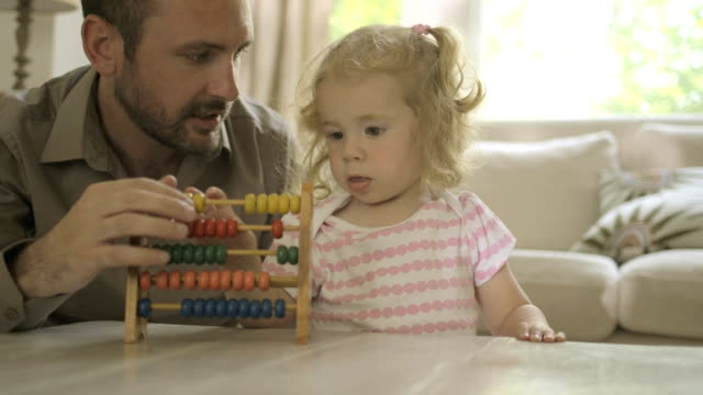father assisting his daughter in counting abacus - modern manhood stock videos & royalty-free footage