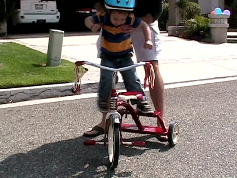 ms, father assisting son (2-3) with tricycle on street, simi valley, california, usa - tricycle stock videos & royalty-free footage