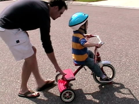 ms, ts, father assisting son (2-3) with tricycle on street, simi valley, california, usa - tricycle stock videos & royalty-free footage