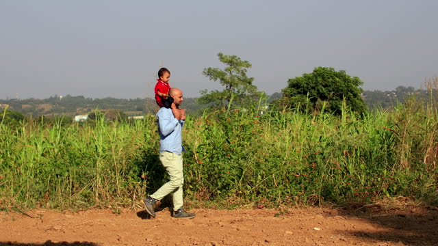 father & baby daughter - sorghum stock videos & royalty-free footage
