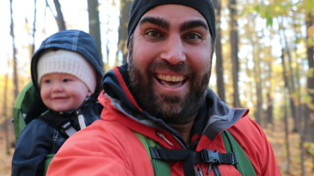 father backpacking hiking with baby in autumn forest - ethnicity stock videos & royalty-free footage