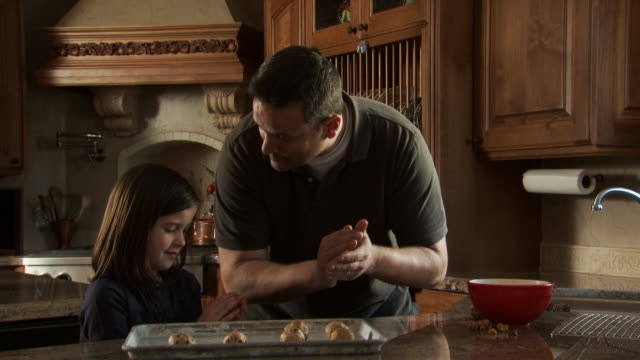 father baking with daughter - see other clips from this shoot 1167 stock videos and b-roll footage