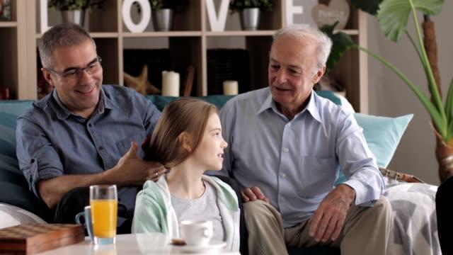 father brushing daughter's hair at home - brushing hair stock videos & royalty-free footage