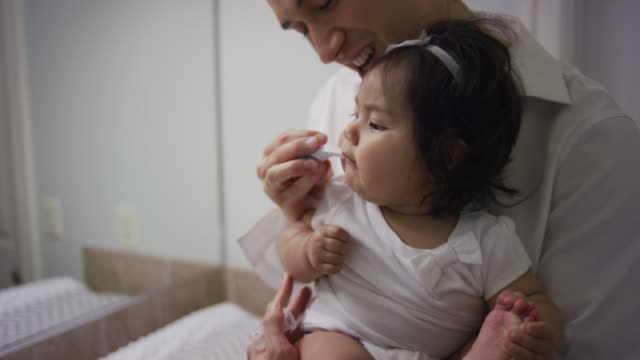 father brushing his baby girl's teeth - brushing stock videos & royalty-free footage