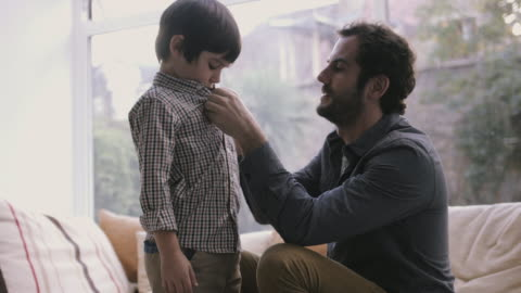 father buttoning little son's shirt - button down shirt stock videos & royalty-free footage
