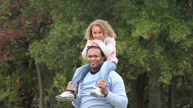 ms father carrying daughter (6-7) on his shoulders / richmond, virginia, usa.  - one parent stock videos & royalty-free footage