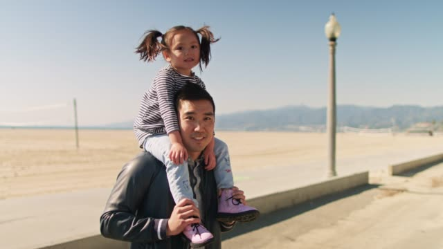 father carrying daughter on shoulders - korean ethnicity stock videos & royalty-free footage