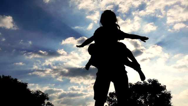 father carrying daughter on the nature park, slow motion - carrying on shoulders stock videos & royalty-free footage