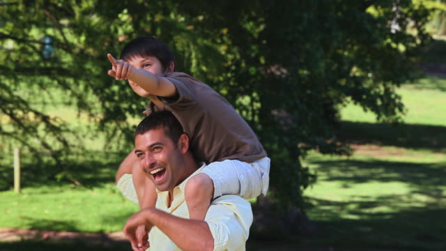 MS TD Father carrying son and enjoying together in Park / Cape Town, Western Cape, South Africa