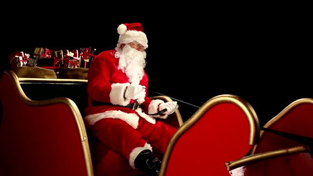 Father Christmas driving his sleigh