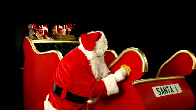 Father Christmas, Santa polishing his sleigh ready for use