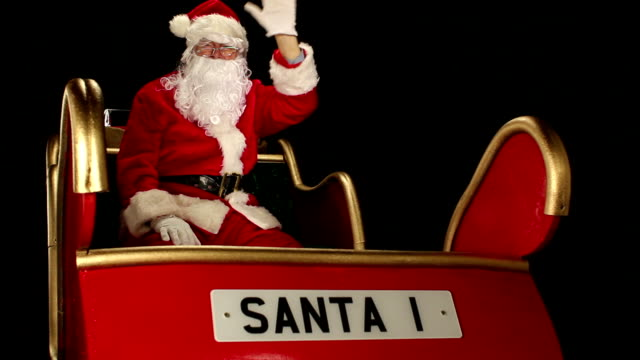 Father Christmas waving from his sleigh
