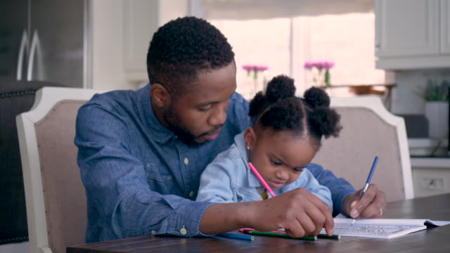 father coloring with his daughter - one parent stock videos & royalty-free footage