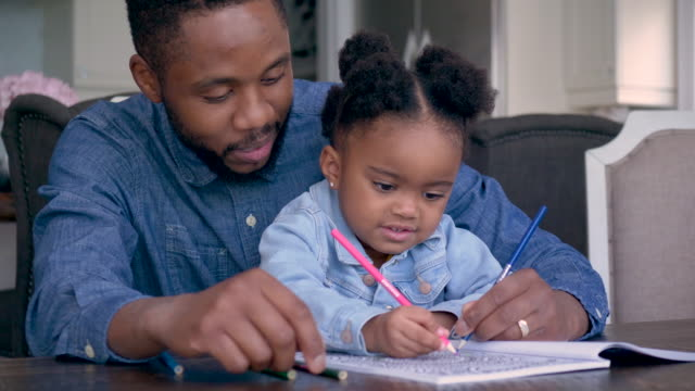 father coloring with his daughter - father's day stock videos & royalty-free footage