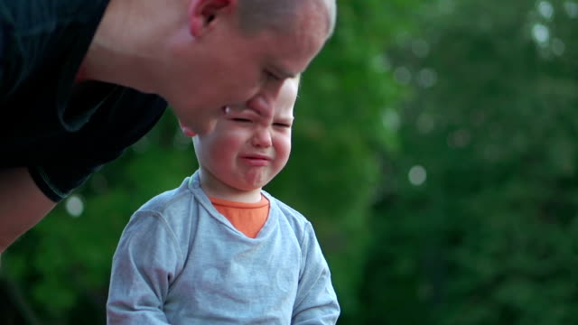 father comforting crying boy - parent stock videos & royalty-free footage