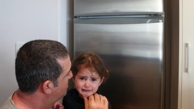 father comforting his crying daughter - 45 49 anni video stock e b–roll