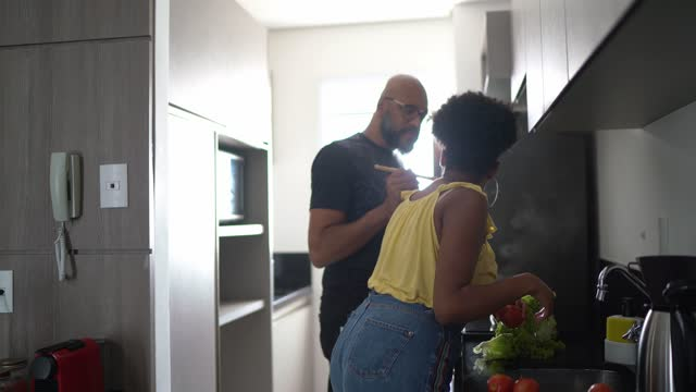 father cooking and daughter washing vegetables at home - afro hairstyle stock videos & royalty-free footage