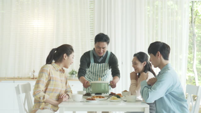 father cooking and serving some food for a family - south korea couple stock videos & royalty-free footage