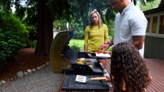 ms zi father cooking at backyard barbecue with family - pacific islander family stock videos & royalty-free footage