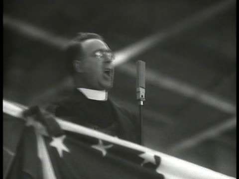 father coughlin at rally speaking gesturing w/ fist. politician al smith standing behind radio microphone. newspaper headline about rally 'coughlin... - 1934 stock videos & royalty-free footage