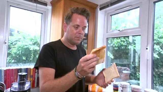 father creates 'toast sculptures' for his daughter who has food allergies england essex leighonsea int adam perry taking two slices of toast out of... - toaster appliance stock videos & royalty-free footage