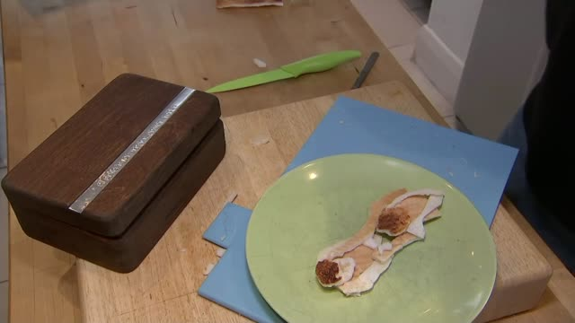 Father creates 'toast sculptures' for his daughter who has food allergies ENGLAND Essex LeighOnSea INT Adam Perry taking two slices of toast out of...