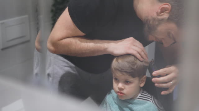 father cutting son's hair at home - domestic bathroom stock videos & royalty-free footage