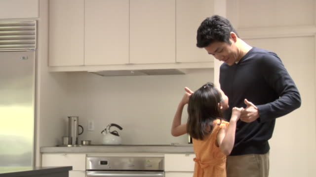 ms, father dancing with daughter (6-7) in kitchen - 20 seconds or greater stock videos & royalty-free footage
