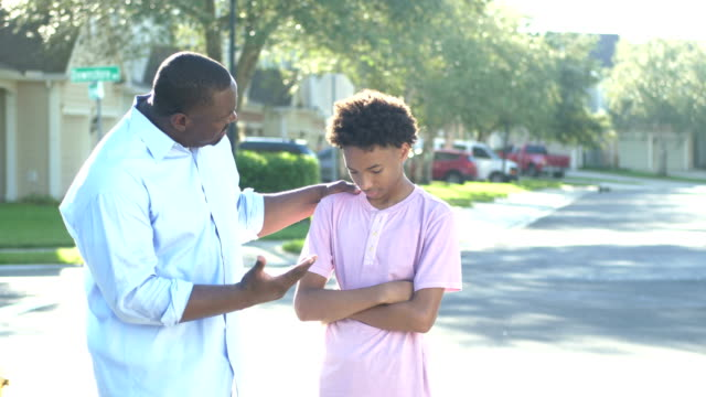 father disciplining teenage son, giving advice - punishment stock videos & royalty-free footage
