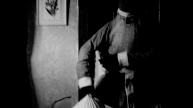 1931 father dressed as santa claus bringing presents - 1931 stock videos & royalty-free footage