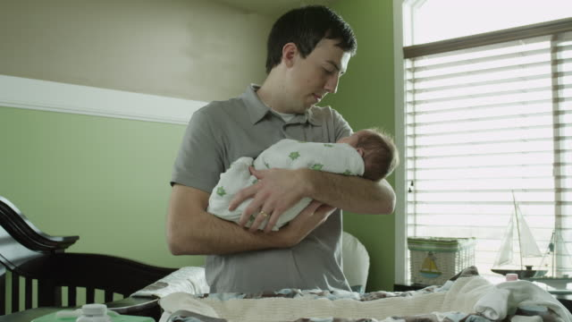 ms father embracing baby boy in nursery / lehi, utah, usa - lehi stock videos & royalty-free footage