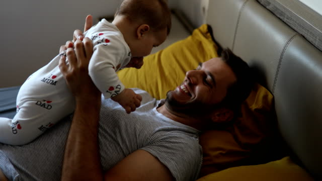 father embracing baby boy - son stock videos & royalty-free footage