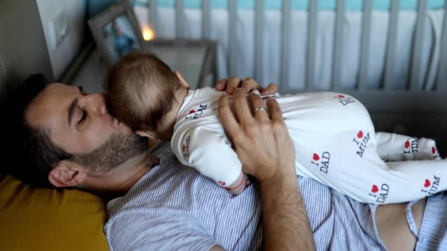 vídeos de stock e filmes b-roll de father embracing baby boy - masculinidade moderna