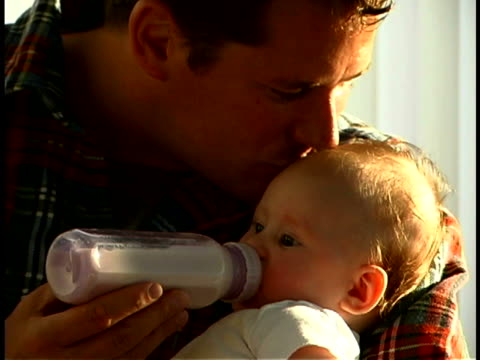 father feeding baby - genderblend stock videos & royalty-free footage
