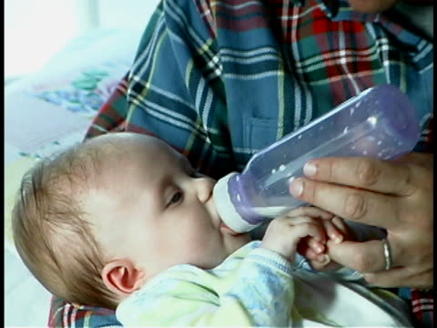 father feeding baby - unknown gender stock videos & royalty-free footage