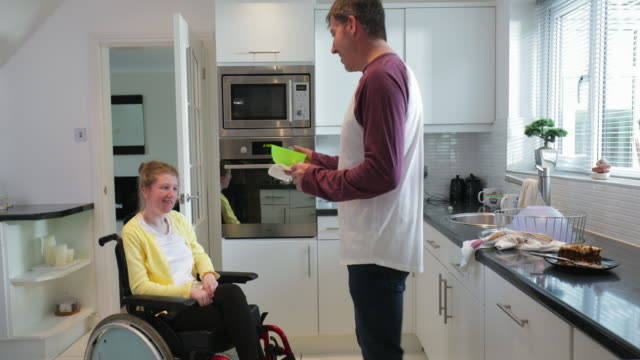 father feeding disabled daughter at home - cerebral palsy stock videos & royalty-free footage
