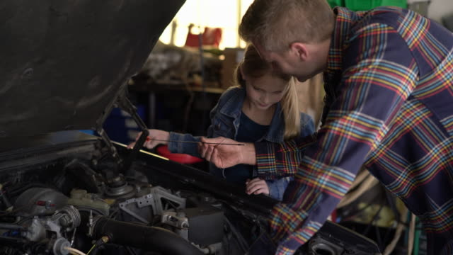 MS Father fixing the car with his daughter
