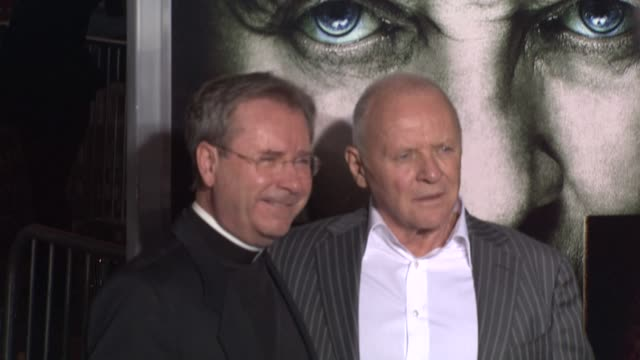 father gary thomas sir anthony hopkins at the 'the rite' premiere at hollywood ca - anthony hopkins stock videos & royalty-free footage