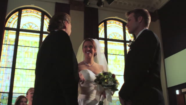 ts father gives daughter to groom at altar - father of the bride stock videos and b-roll footage