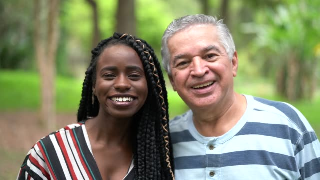 father / grandfather with daughter - adoption / friendship concept - adoption stock videos and b-roll footage