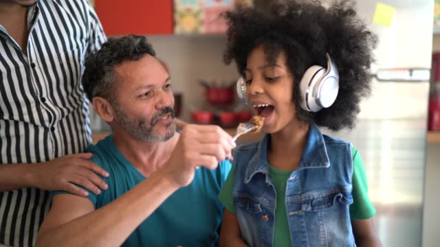 father having fun feeding daughter - 50 54 years stock videos & royalty-free footage