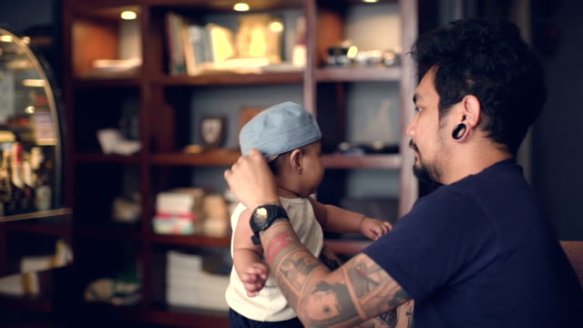father helping a baby to stand up and talking - tattoo stock videos & royalty-free footage